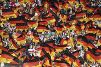 Germany's fans wave German national flags as they cheer prior to the Russia 2018 World Cup Group F football match between Germany and Mexico at the Luzhniki Stadium in Moscow on June 17, 2018. / AFP PHOTO / PATRIK STOLLARZ / RESTRICTED TO EDITORIAL USE - NO MOBILE PUSH ALERTS/DOWNLOADS