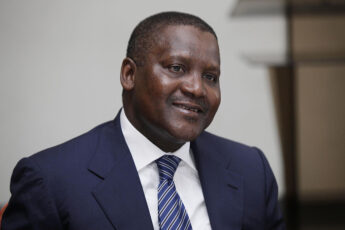 FILE -  In this photo taken, Monday, Oct. 8, 2012 Nigerian billionaire businessman Aliko Dangote  attends  a global business environment meeting in Lagos, Nigeria. Forbes magazine says Dangote, a Nigerian tycoon who built his empire on commodities like flour, sugar and cement, is Africa's richest man. Dangote topped the Forbes' list published this week for the second year running. According to Forbes, he has a net worth of $12 billion. (Ap Photo/Sunday Alamba, file)